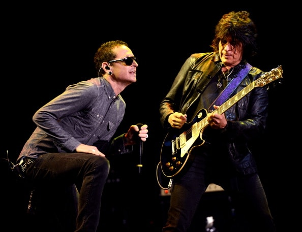 LOS ANGELES, CA - MAY 30:  Musician Chester Bennington of Linkin Park (L) and Dean DeLeo of Stone Temple Pilots perform at the 9th Annual MusiCares MAP Fund Benefit Concert at Club Nokia on May 30, 2013 in Los Angeles, California.  (Photo by Kevin Winter/Getty Images)