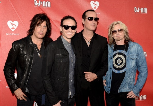 LOS ANGELES, CA - MAY 30:  (L-R) Musicians Dean DeLeo, Chester Bennington, Robert DeLeo and Eric Kretz of Stone Temple Pilots at the 9th Annual MusiCares MAP Fund Benefit Concert at Club Nokia on May 30, 2013 in Los Angeles, California.  (Photo by Kevin Winter/Getty Images)
