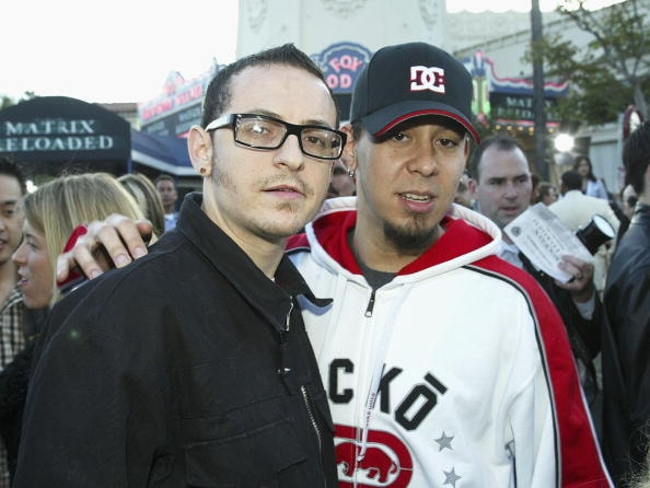 "LOS ANGELES - MAY 7:  Linkin Park's Mike Shinoda (L) and Chester Bennington arrive at the premiere of ""The Matrix Reloaded"" at the Village Theater on May 7, 2003 in Los Angeles, California. (Photo by Kevin Winter/Getty Images)"