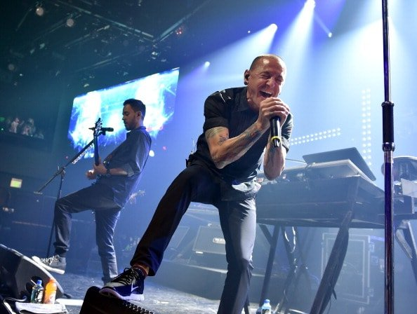 BURBANK, CA - JUNE 18:  Musician Mike Shinoda (L) and singer Chester Bennington perform onstage during the iHeartRadio album release party with Linkin Park presented by Clear Channel at the iHeartRadio Theater on June 18, 2014 in Burbank, California.  (Photo by Kevin Winter/Getty Images for Clear Channel)