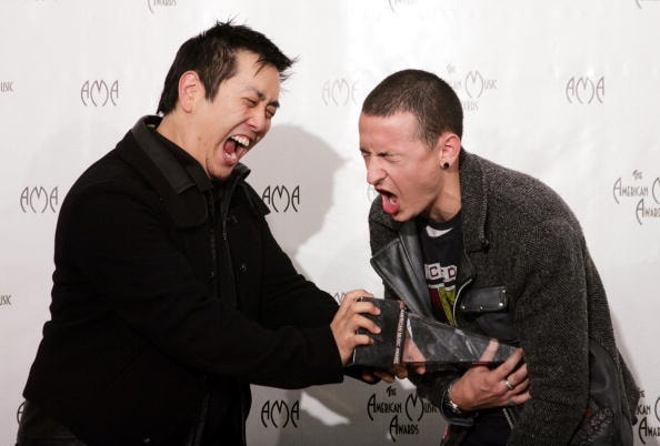 "LOS ANGELES - NOVEMBER 14:  Musicians Joseph Hahn and Chester Bennington from the band Linkin Park pose in the press room at the 32nd Annual ""American Music Awards"" at the Shrine Auditorium November 14, 2004 in Los Angeles, California. (Photo by Carlo Allegri/Getty Images)"