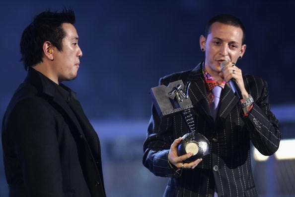 ROME - NOVEMBER 18:  Chester Bennington (R) of Linkin Park accepts the award for Best Rock during the MTV Europe Music Awards 2004 at Tor di Valle November 18, 2004 in Rome, Italy.  (Photo by Frank Micelotta/Getty Images)