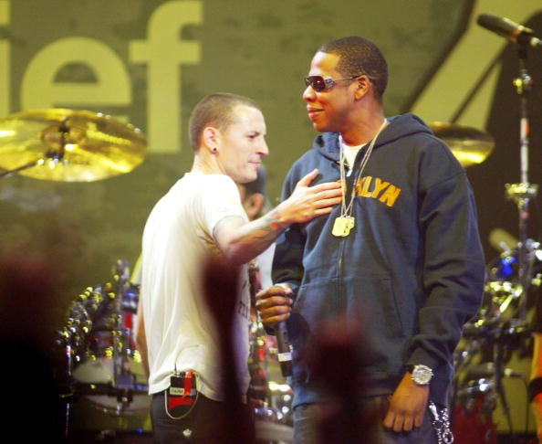 "LOS ANGELES - FEBRUARY 18: Chester Bennington of Linkin Park and Jay-Z perform during the ""Music for Relief"" tsunami benefit concert at the Anaheim Pond on February 18, 2005 in Anaheim, California.(Photo by Matthew Simmons/Getty Images)"