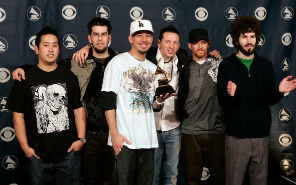 LOS ANGELES, CA - FEBRUARY 08:  The group Linkin Park poses with their award for Best Rap/Sung Collaboration in the press room at the 48th Annual Grammy Awards at the Staples Center on February 8, 2006 in Los Angeles, California.  (Photo by Kevin Winter/Getty Images)