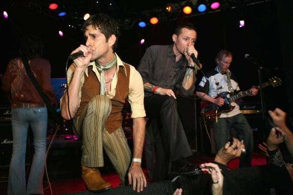 WEST HOLLYWOOD, CA - NOVEMBER 08: Perry Farrell, Chester Bennington of Linkin Park and Robby Krieger of The Doors perform in the The Doors 40th Anniversary Celebration at the Whiskey A Go Go on November 8, 2006 in West Hollywood, California.  (Photo by Chad Buchanan/Getty Images)