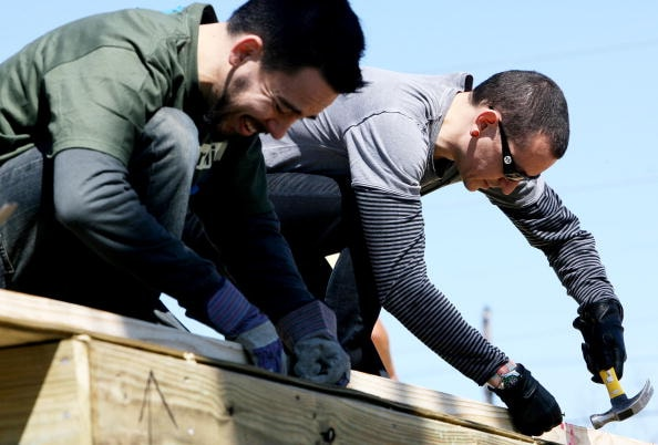 NEW ORLEANS - FEBRUARY 27: (L to R) Mike Shinoda and Chester Bennington of the band Linkin Park use hammers to nail frames together as they work with Music for Relief and Habitat for Humanity while rebuilding homes affected by Hurricane Katrina on February 27, 2008 in New Orleans, Louisiana.(Photo by Sean Gardner/Getty Images)