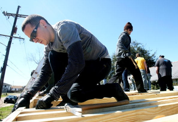 NEW ORLEANS - FEBRUARY 27: Chester Bennington (L) of the band Linkin Park lines up board before hammering frames together as he works with Music for Relief and Habitat for Humanity while rebuilding homes affected by Hurricane Katrina on February 27, 2008 in New Orleans, Louisiana.(Photo by Sean Gardner/Getty Images)