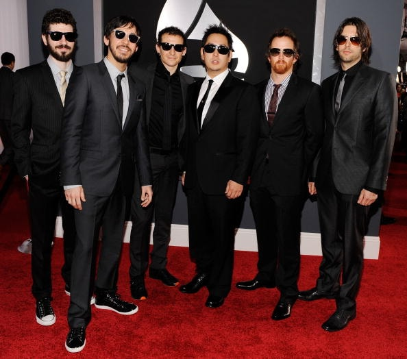 "LOS ANGELES, CA - JANUARY 31:  (L-R) Musicians Brad Delson, Mike Shinoda, Chester Bennington, Joe Hahn David ""Phoenix"" Farrell and Rob Bourdon of the band Linkin Park arrive at the 52nd Annual GRAMMY Awards held at Staples Center on January 31, 2010 in Los Angeles, California.  (Photo by Larry Busacca/Getty Images for NARAS)"